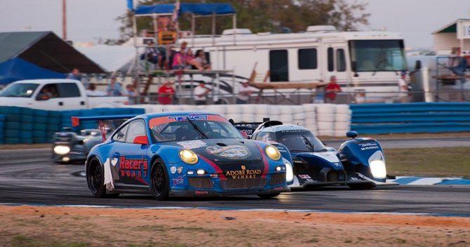 Peugot car 7 passes TRG Racing car 066 inside at turn 5