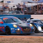 Peugot car 7 takes the inside at turn 5, passing TRG Racing car 066