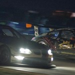 BMW number 56 overtakes Alex Job Porsche 023 in Big Bend