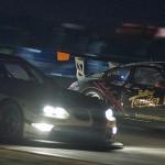 BMW number 56 overtakes Alex Job Porsche 023 in Big Bend