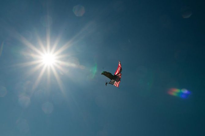 Flying the flag, literally. A parachutist floats to earth with the American Flag at Petit Le Mans