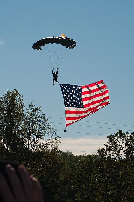 Parachutist lands the flag at the start-finish straight, Road Atlanta, Petit Le Mans, 2011
