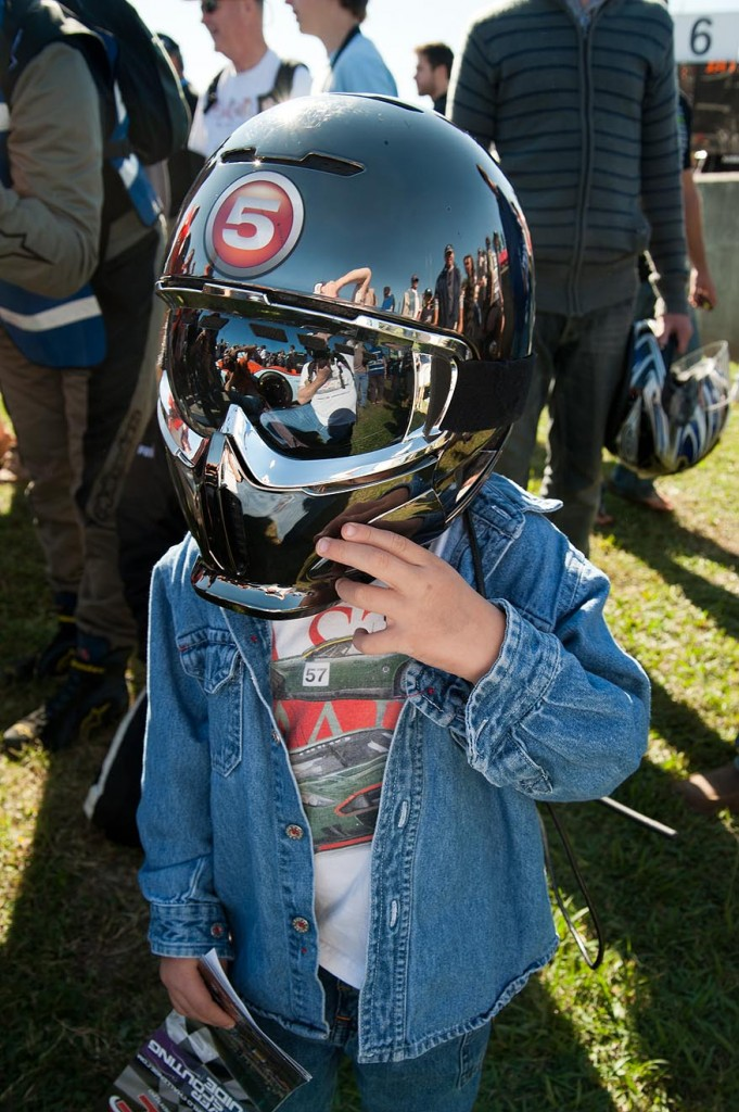 Young man in-helmet, thanks to a Level 5 Motorsports crew member